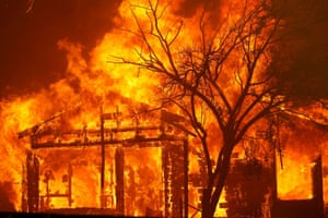 A home burns in Cherry Glen Road on the outskirts of Vacaville, California, on Wednesday.