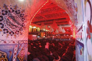 In this file photo from 10 September 2019, Shiite Muslim worshippers pray inside the shrine of Imam Abbas on the holy day of Ashoura, in Karbala, Iraq.