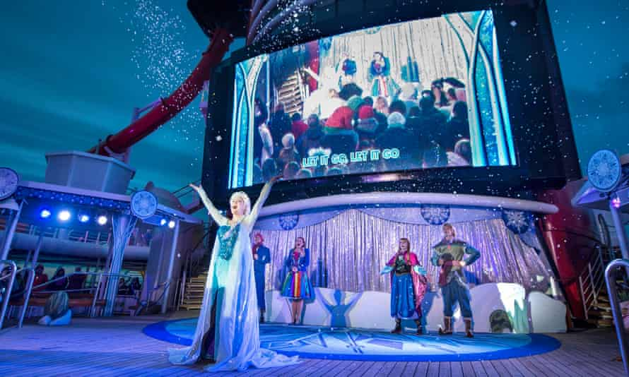 A singer performs in front of actors as part of a Disney themed cruise ship holiday.