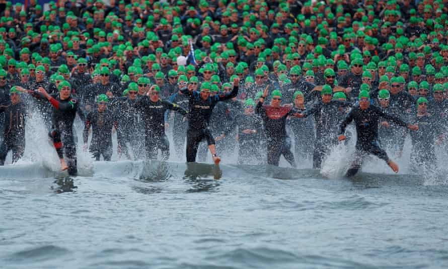 Athletes compete during the swim section