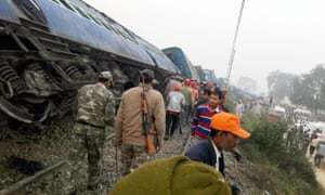 Rescue officials assess the damage to one of the 14 carriages that derailed on the the Indore-Patna express route.