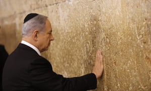 Netanyahu touches the Western Wall after his election victory.