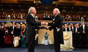 Handke (left) receives the 2019 Nobel prize in literature from King Carl XVI Gustaf (right) of Sweden during the ceremony at Stockholm Concert Hall on Tuesday.