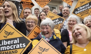Liberal Democrat supporters celebrate the party's success in the local elections in Chelmsford, Essex.