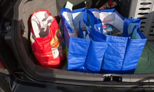 Loading the weekly shop into the boot of the car using 'bag for life' carriers.
