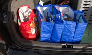 Loading the weekly shop into the boot of the car