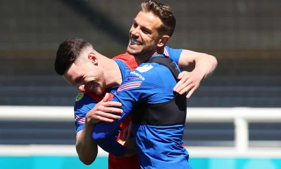 Jordan Henderson jokes with teammate Declan Rice during an England training session at St George's Park on Wednesday