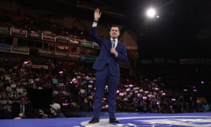 Pete Buttigieg waves to the crowd in Manchester, New Hampshire, on 8 February.
