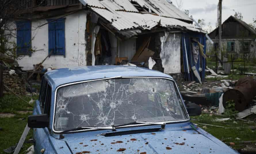 Damaged vehicle between Debaltseve and Luhansk in Ukraine