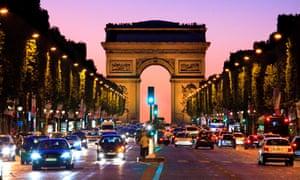 The Arc de Triomphe and Champs Élysées in Paris at night.