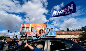 People take to the streets in Los Angeles, waving the flag for Joe Biden