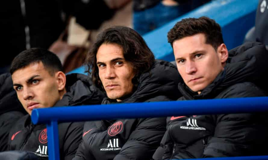 Edinson Cavani centre) watches on from the substitutes' bench as PSG play Monaco earlier this month.
