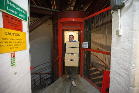 An employee carries boxes of micro-green salad from the elevator Growing Underground. The farm's clients include Tesco, Marks & Spencer and Ocado.
