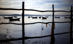 Fishing boat moored in a region of Chile affected by the largest red tide in its history, prompting fishermen deprived of their livelihoods to angrily demand government support.