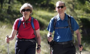 Theresa May and her husband, Philip, walking in the Swiss Alps last summer.
