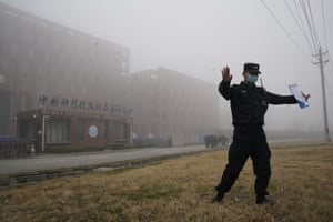 A security person moves journalists away from the Wuhan Institute of Virology after a World Health Organisation team arrived for a field visit in Wuhan.