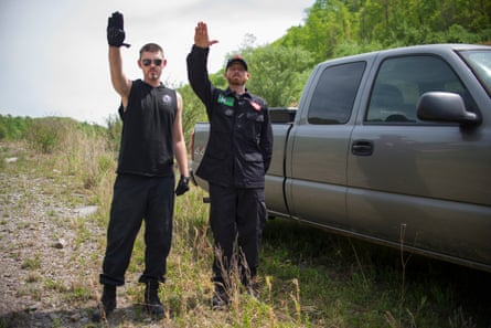 KKK members salute next to a pickup truck at a private campground in Whitesburg, Kentucky.
