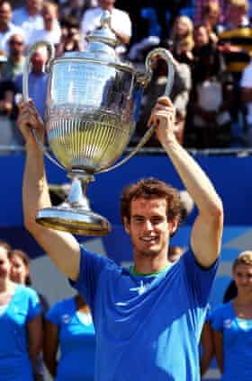 Andy Murray of Great Britain celebrates winning his Men's Singles final against Jo-Wilfred Tsonga of France on day eight of the AEGON Championships at Queens Club on June 13, 2011 in London, England