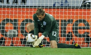 Rob Green misjudges a shot by Clint Dempsey to concede a goal in England's opening World Cup game against USA.