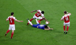 Arsenal's Ainsley Maitland-Niles concedes a penalty after fouling Chelsea's Olivier Giroud.