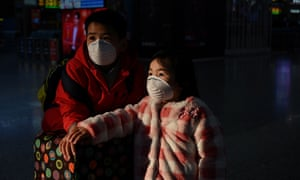Schools across Shanghai are to remain shut until the end of February. Here's a photo by AP of a child wearing a protective face mask at the usually full Hongqioa train station in Shanghai. Some reports suggest the city is unusually quiet for this time of year, with businesses closing their doors and residents choosing to remain inside.