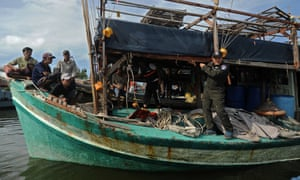 Vietnamese fishermen on their seized boat after they were detained at sea by the Thai Royal Marine Police in Thailand's province of Narathiwat on 14 February 14 2016.