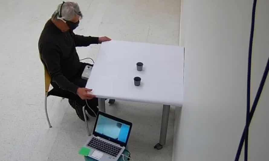 Man successfully locates various objects placed on a table with his non-treated eye covered and treated eye open and wearing light-stimulating goggles
