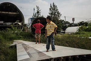Impoverished Thai families live in disused airplanes in a vacant lot in Bangkok