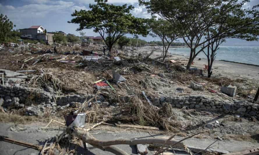 Debris litters Wina beach in Palu