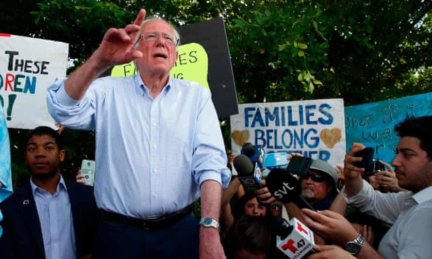 Bernie Sanders stands looks into a detention center for migrant children in Homestead, Florida, on 26 June 2019. The Trump administration announced Monday it would close the facility.