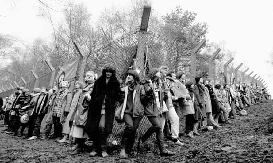 Peace activists chain themselves to a fence surrounding RAF Greenham Common in 1981.