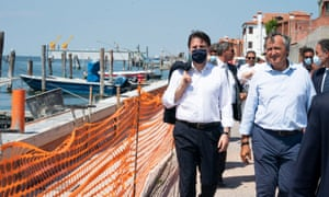 Italy's prime minister, Giuseppe Conte, left, after the general test of the Mose sluice gates in Venice