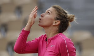Simona Halep crosses herself and blows a kiss to the sky after winning her second round .