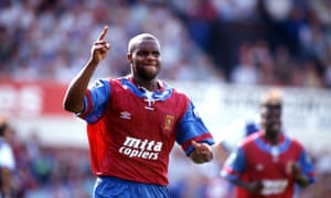 Dalian Atkinson celebrates while playing for Villa.