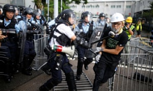 Police try to disperse protesters in Hong Kong.