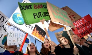 Children taking part in a climate change protest in London