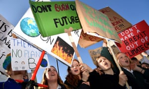 Protesters hold placards as they attend a climate change protest organised by Youth Strike 4 Climate opposite the Houses of Parliament in London last Friday