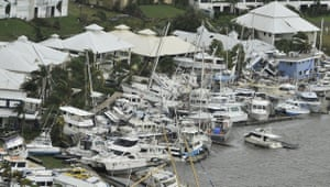 Yachts lie badly damaged after breaking free from their moorings when Cardwell, Queensland, bore the brunt of cyclone Yasi's 180mph winds.