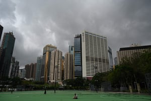 A man (C) sits in the grounds of an empty Victoria Park in the Causeway Bay district of Hong Kong on June 4, 2021.