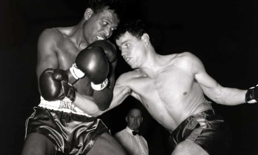 Terry Downes, right, on the attack against Sugar Ray Robinson in 1962. Downes won the 10-round fight on a points decision.