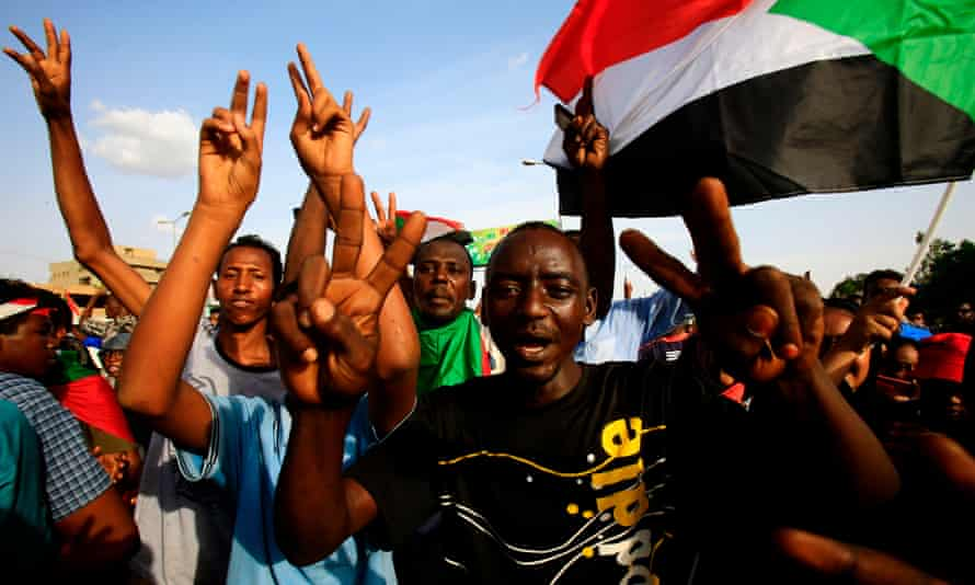 Sudanese protesters at a rally in Khartoum mourning deaths of dozens of demonstrators