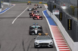 Safety car leads the field.