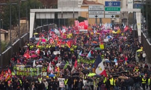 People holding flags and banners take part in a demonstration to protest against the pension overhauls, in Perpignan.