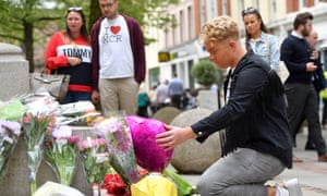 Members of the public pay tribute to victims of the Manchester Arena bombing on the second anniversary.