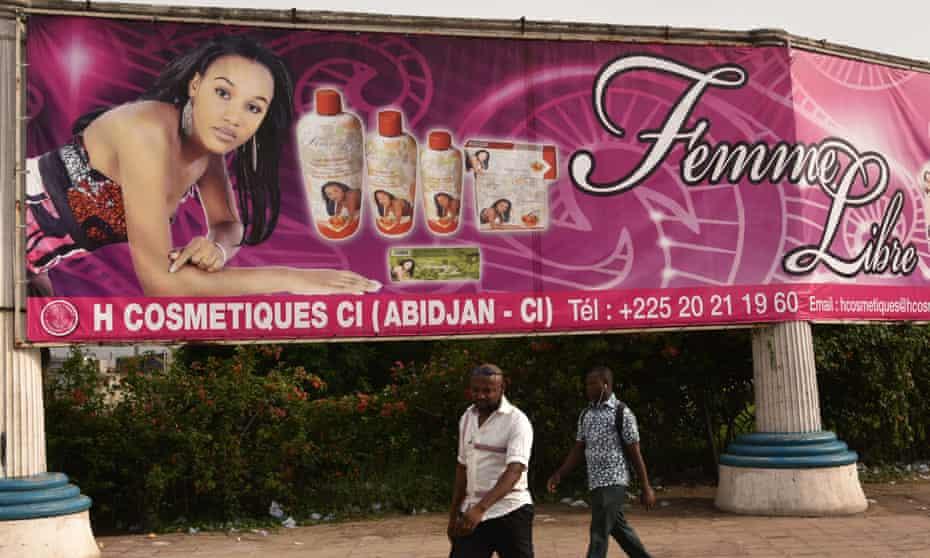 An advertising placard of skin-lightening products in Abidjan. Ivory Coast's government has forbidden the use of skin-lightening products, the health ministry has announced.
