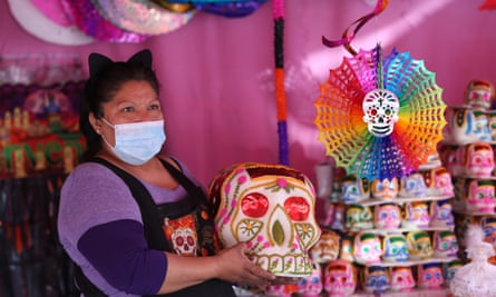 Merchants in the Jamaica market offer their products for the Day of the Dead festivities, in Mexico City.