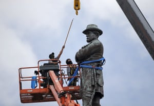 In May 2017, workers prepare to take down a statue of former Confederate Gen Robert E Lee in New Orleans.