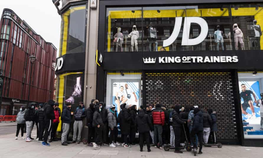 Queue of people outside JD Sports in Oxford Street.