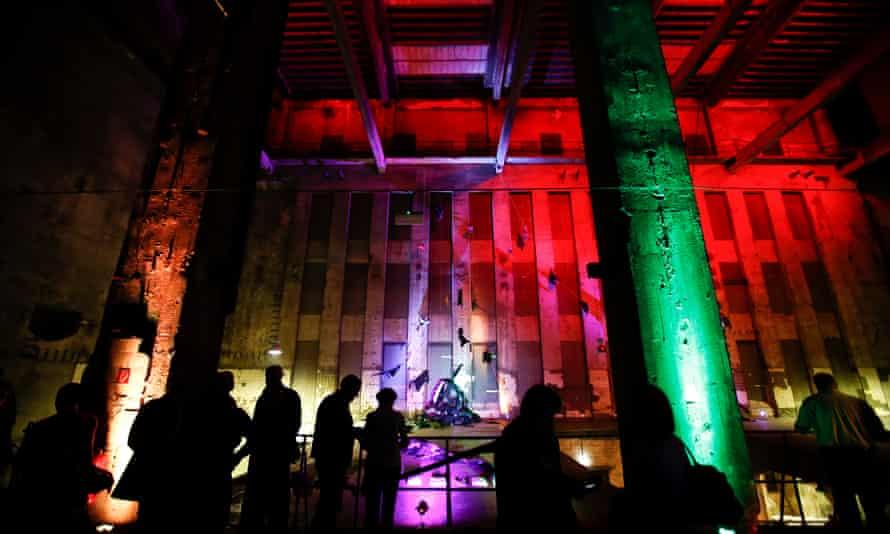 Illuminated exterior of Berlin's Berghain club.