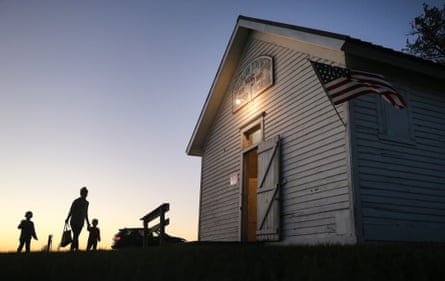 People enters a polling place at Sherman Township Hall, a former one room schoolhouse, in Zearing, Iowa.